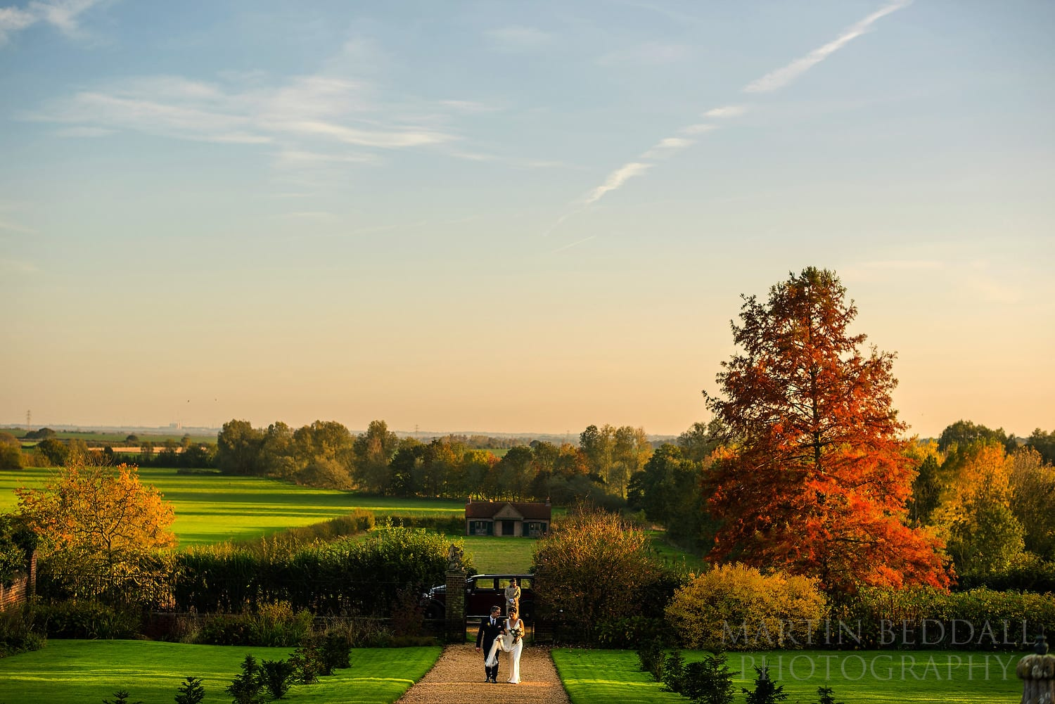 Bride and groom arrive at Layer Marney Tower in the autumn sunshine