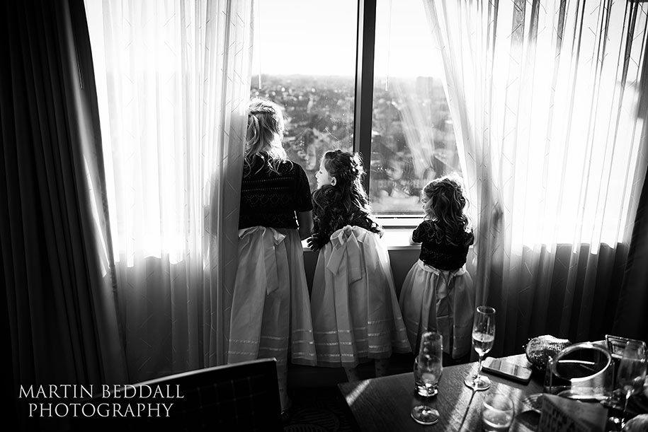 Flower girls looking out of the hotel window
