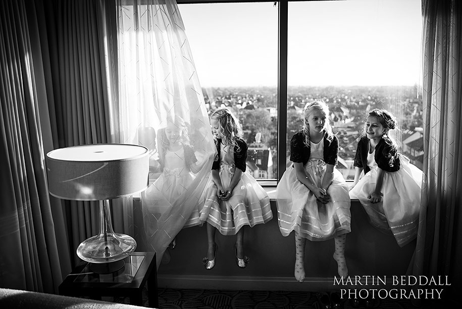 Flowergirls waiting on the window sill