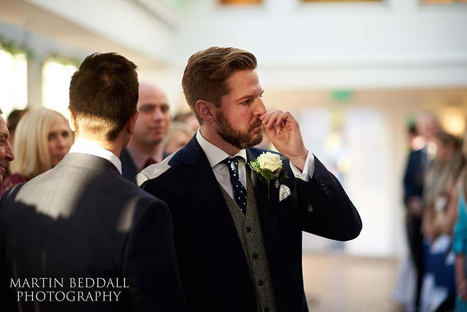 Emotional groom in the aisle