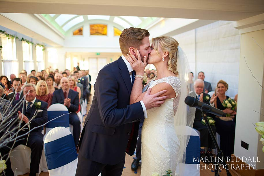 Pembroke Lodge wedding ceremony bride and groom kiss