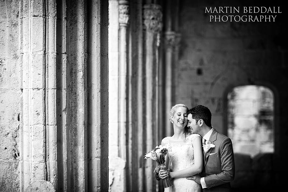 Bride and groom portrait in the ruins of Bellpais abbey