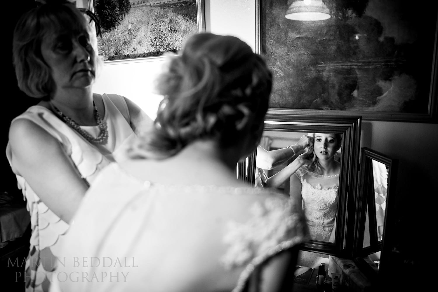 Bride getting ready with help from her mother
