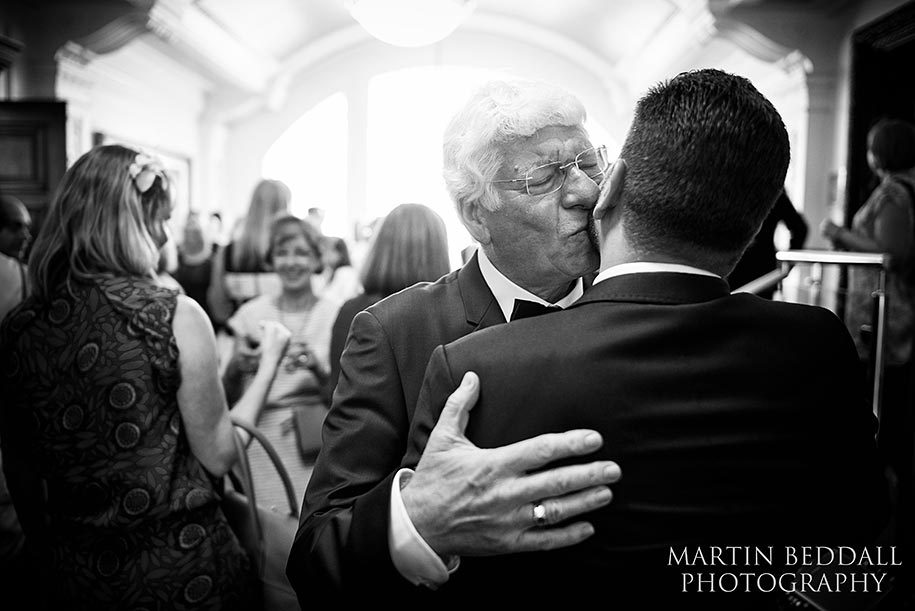 Groom kissed by his father