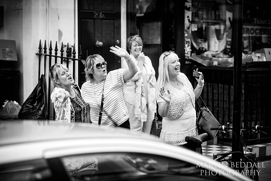 Passers by sing to the bride