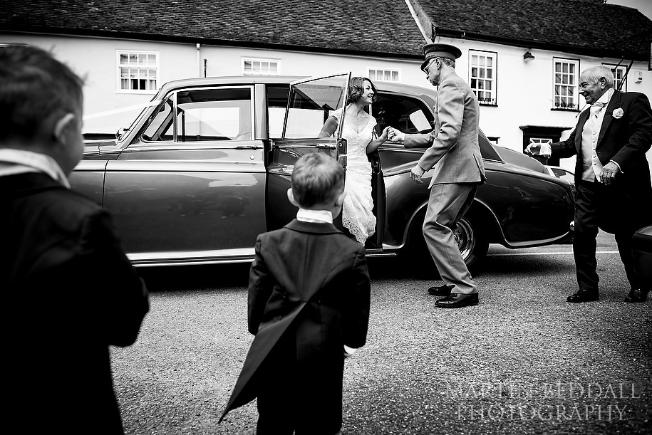 Bride arrives at the church watched by her sons