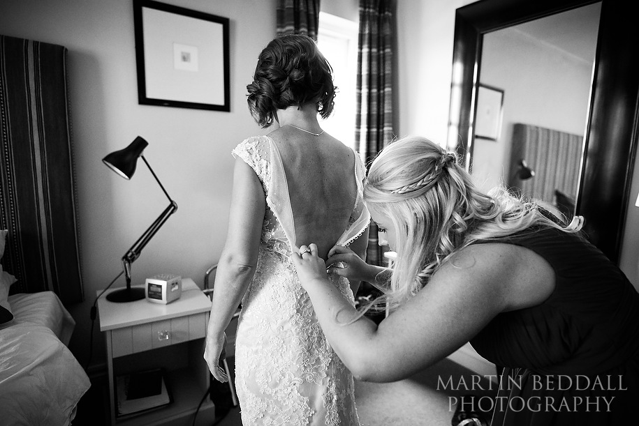 Doing up the wedding dress