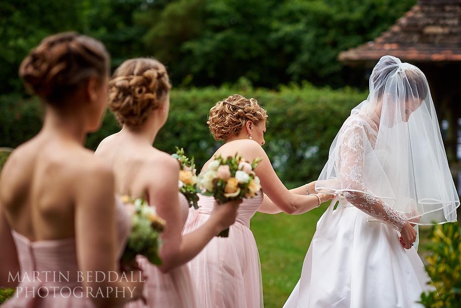 Bridesmaids help get the bride ready