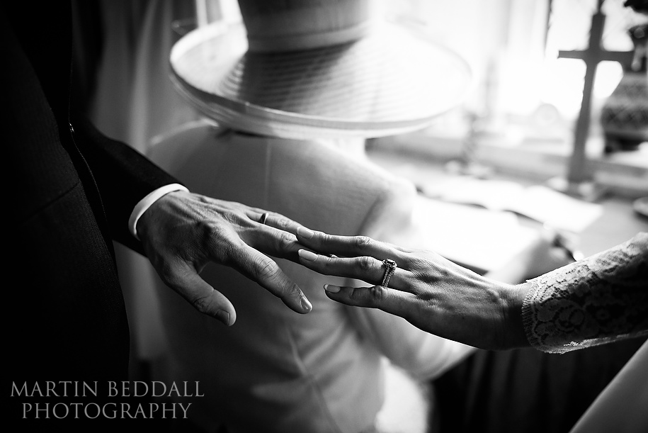 Bride and groom compare rings