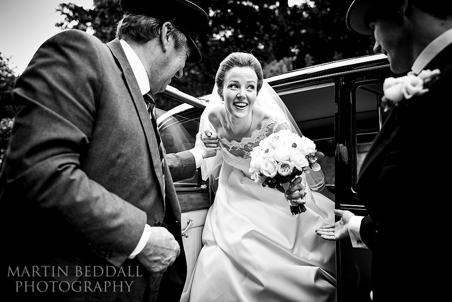 Bride gets out of the wedding car at Nutfield Priory