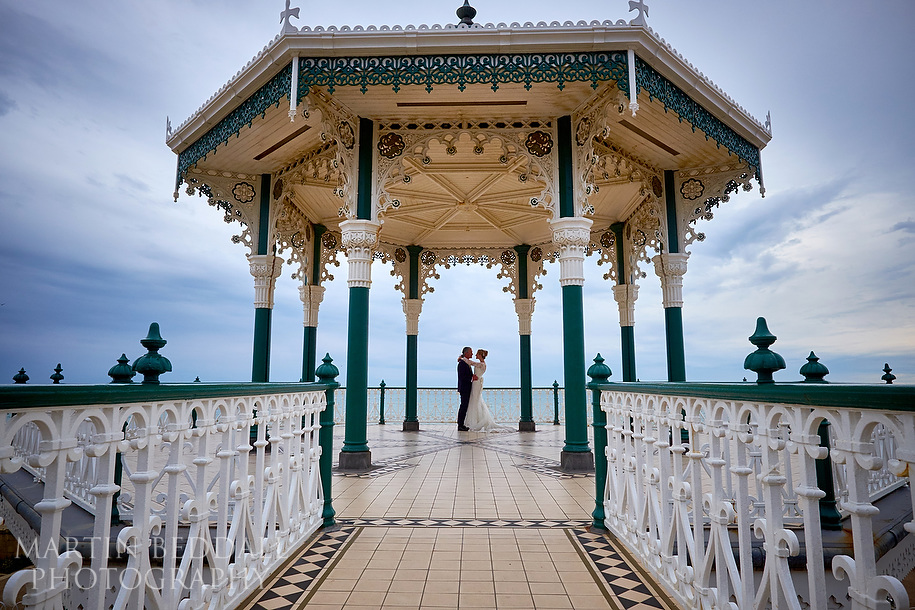 Brighton seafront bandstand bride and groom portrait