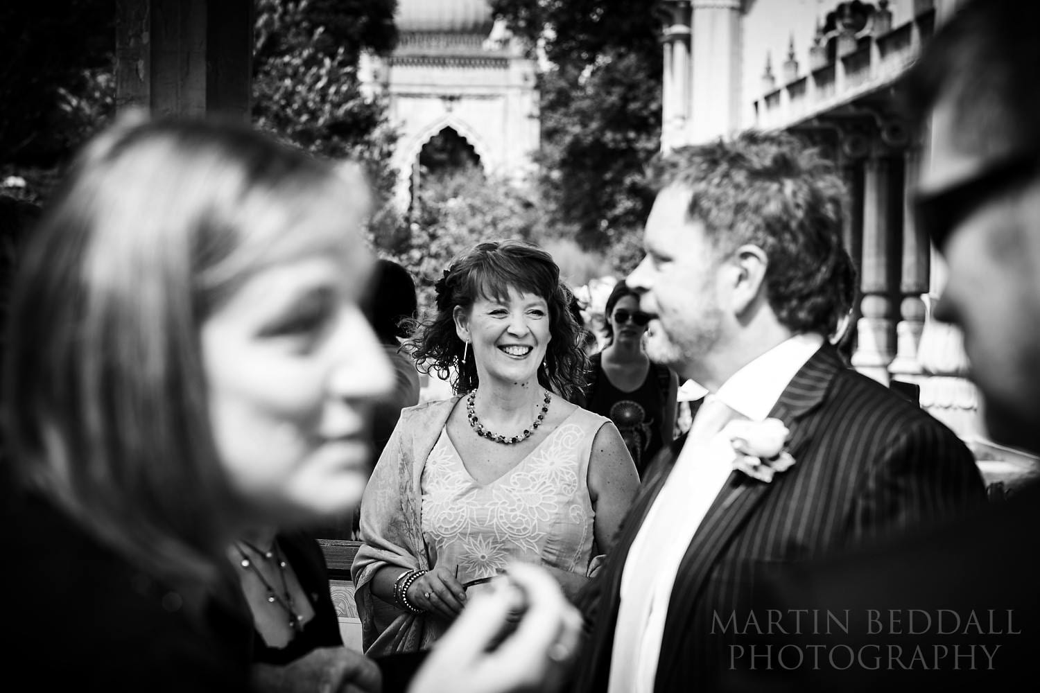 Wedding guests gather outside the Royal Pavilion in Brighton