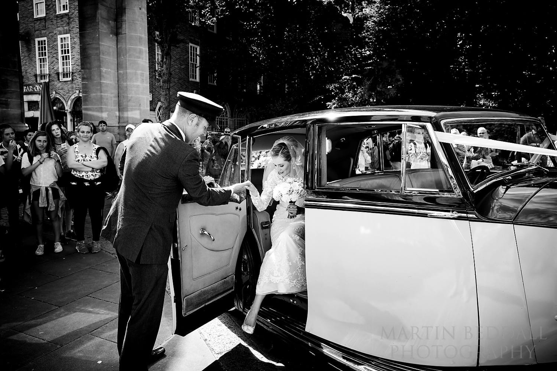 Bride arrives by wedding car at the Royal Pavilion wedding in Brighton