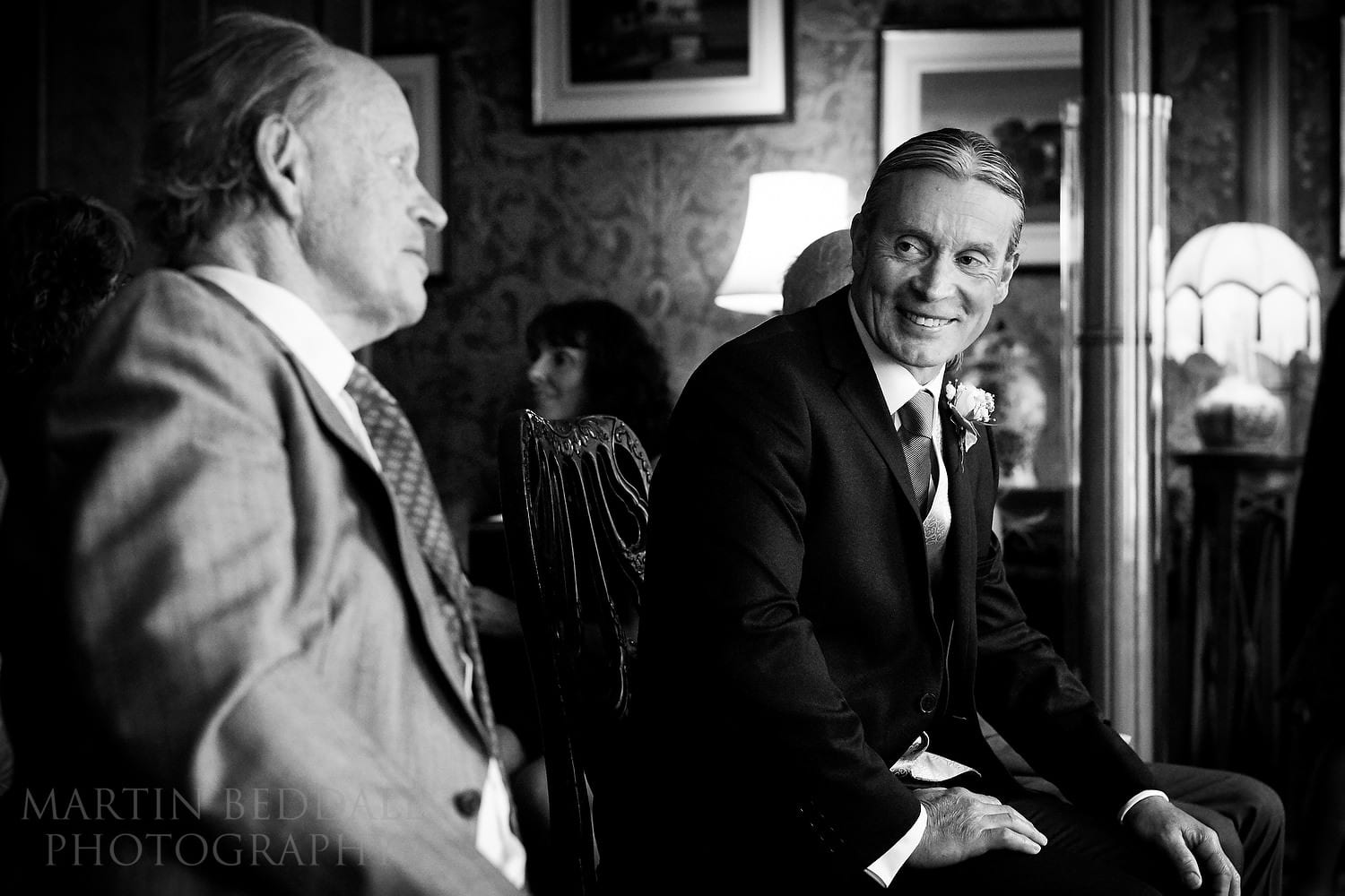 Groom and his father sat in the Red Drawing Room at the Royal Pavilion