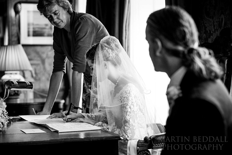 Signing the register at Royal Pavilion wedding