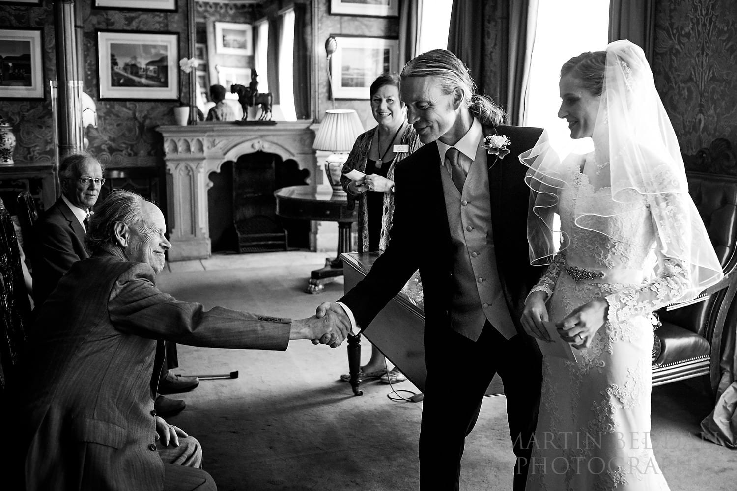 Groom shakes his father's hand