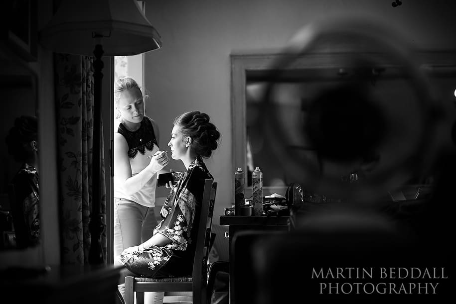 Bridesmaid getting ready at Caswell House wedding