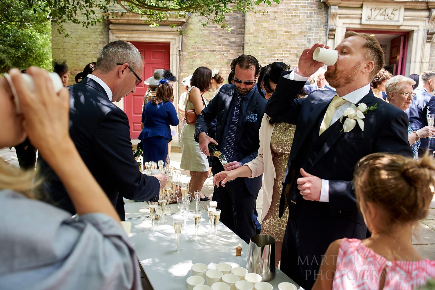Drinks in the churchyard after the wedding ceremony at Hampstead Parish Church