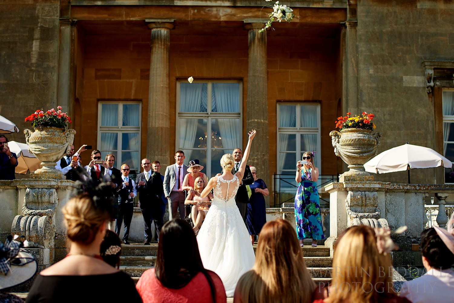 Throwing the wedding bouquet at Luton Hoo