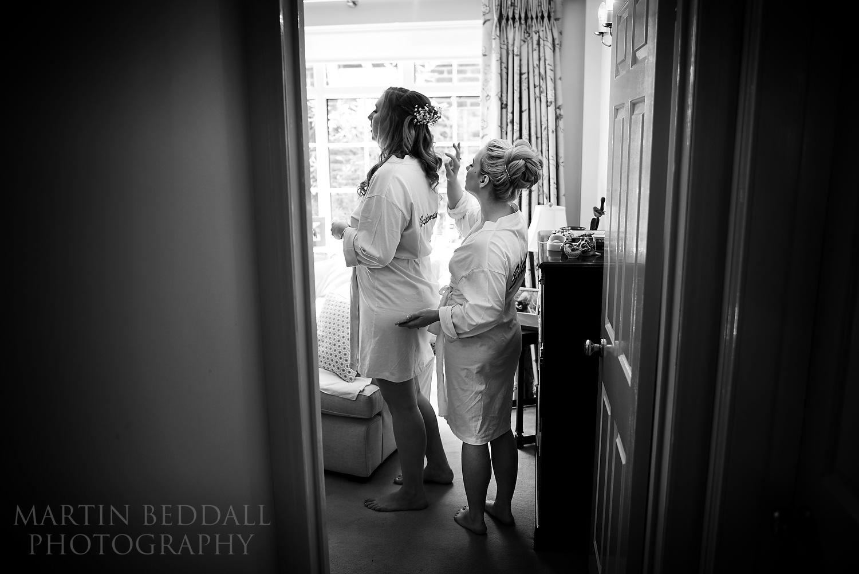 Bride helps taller bridesmaid