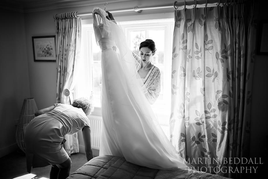 Bride gets her wedding dress ready