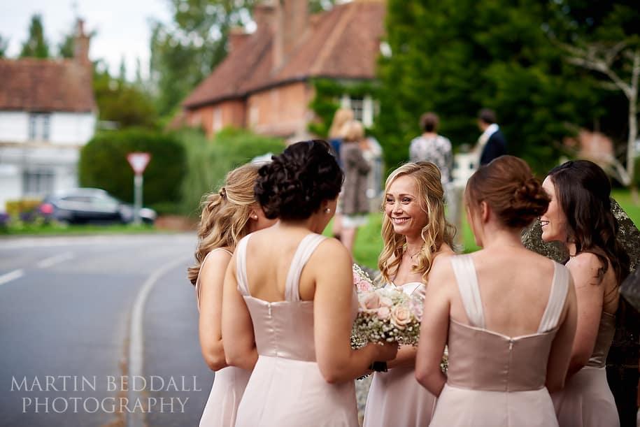 Bridesmaids wait for the bride
