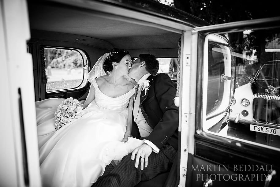 Kiss in the wedding car