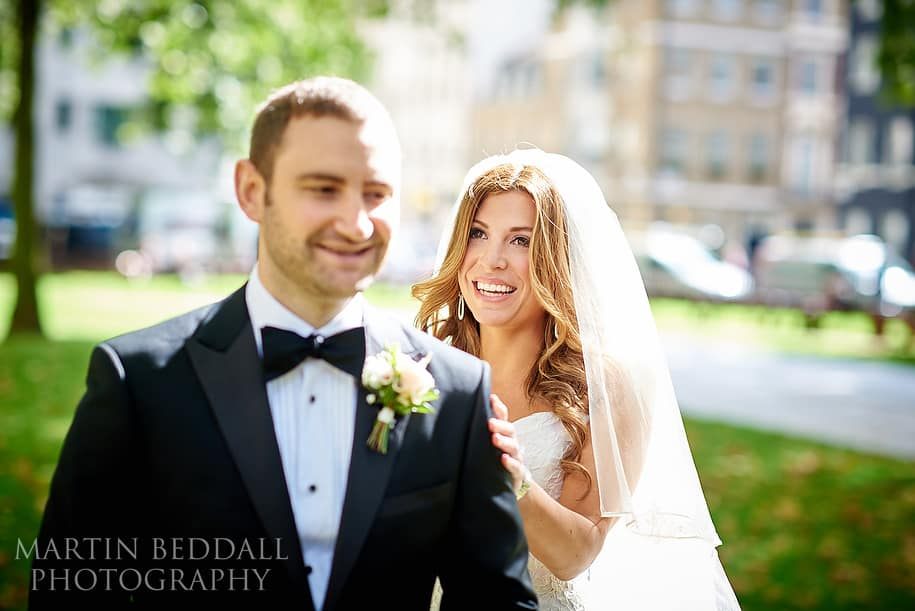 Bride and groom first look in Berkeley Square London