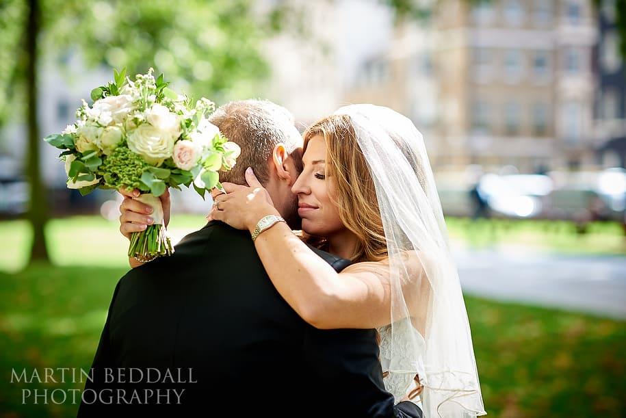 Bride and groom first look in Berkeley Square London