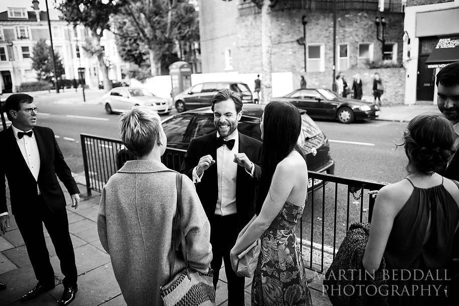 Groom greets arriving wedding guests at the Amadeus