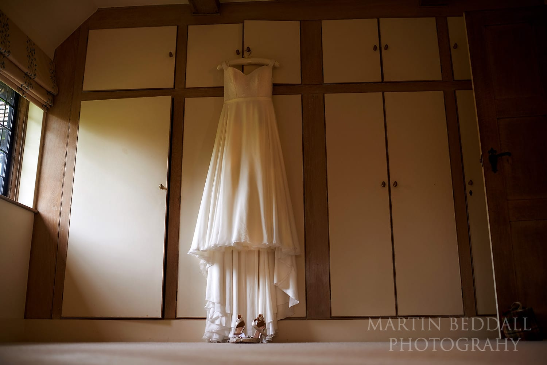 Bride's wedding dress hanging up