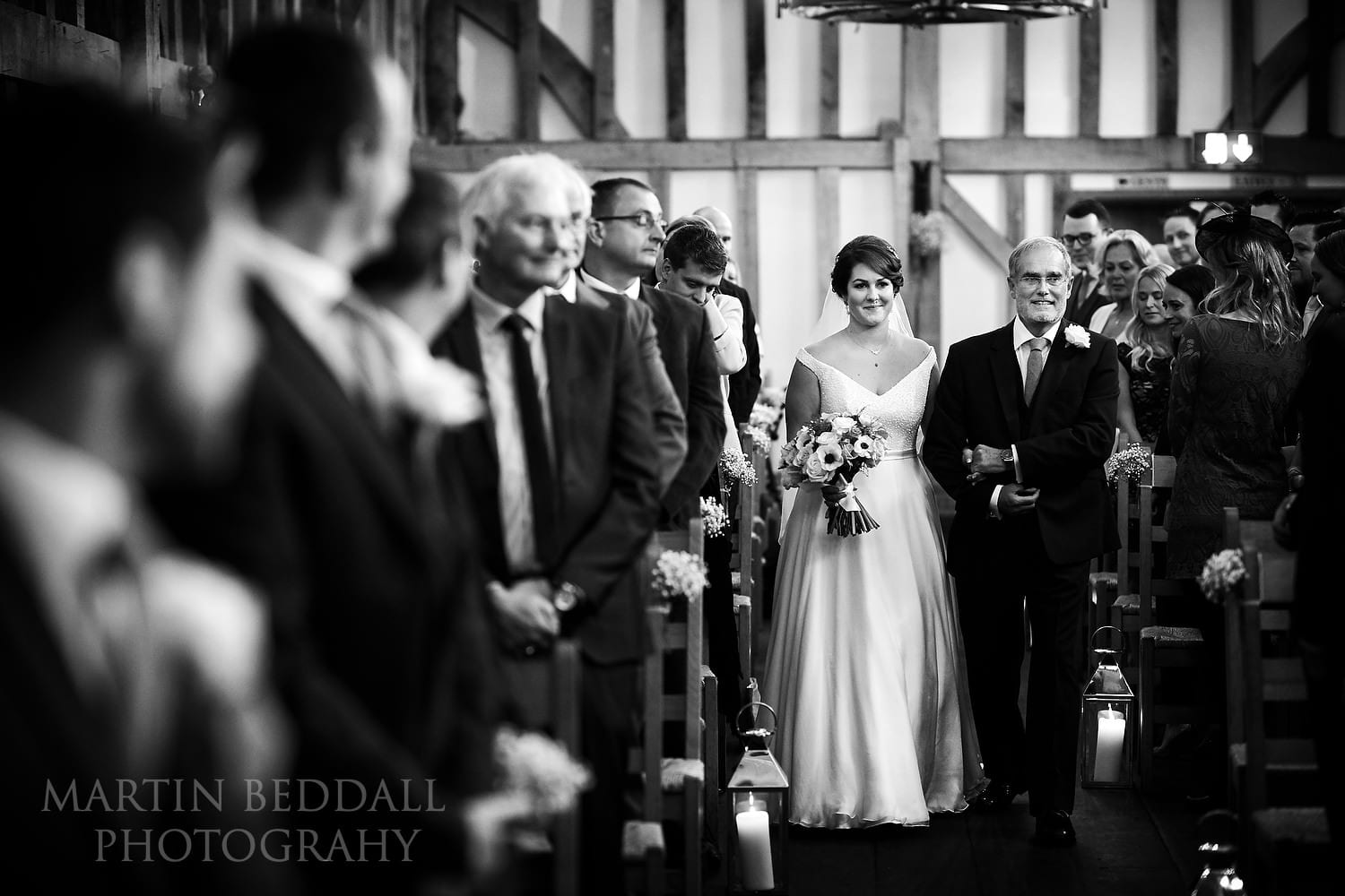 Bride walks down the aisle with her father at Gate St Barn