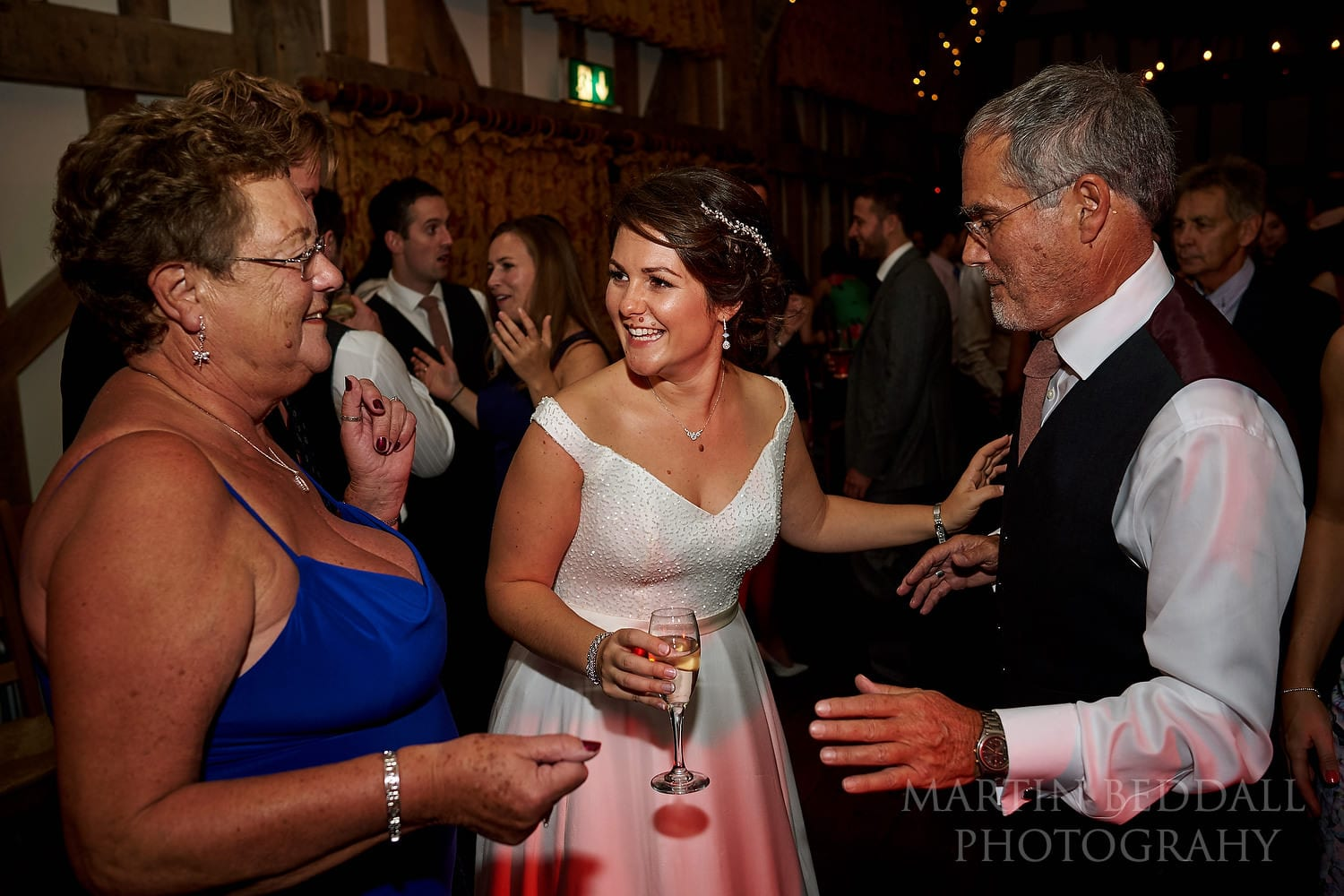 Bride dances with her parents at Gate St Barn