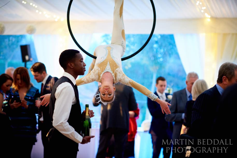 Trapeze act in the wedding marquee
