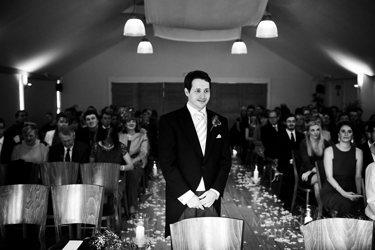 Groom waits in the ceremony room at Wasing Park