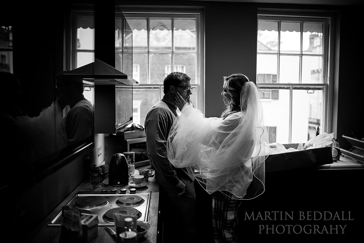 Quiet moment between a bride and her father