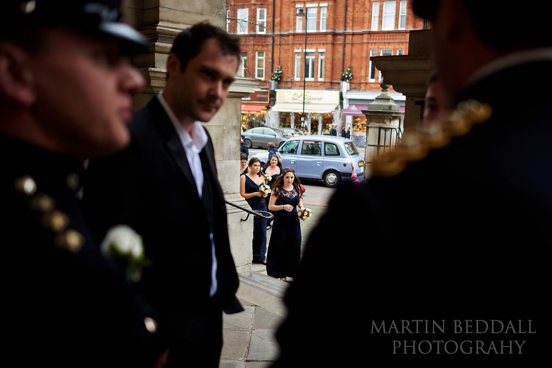 Bridesmaids arrive at Brompton Oratory