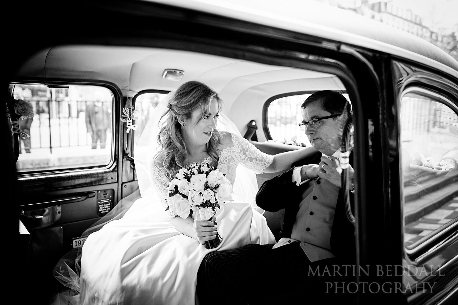 Bride and her father arrive at Brompton Oratory