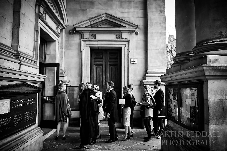 Wedding guests enter Brompton Oratory
