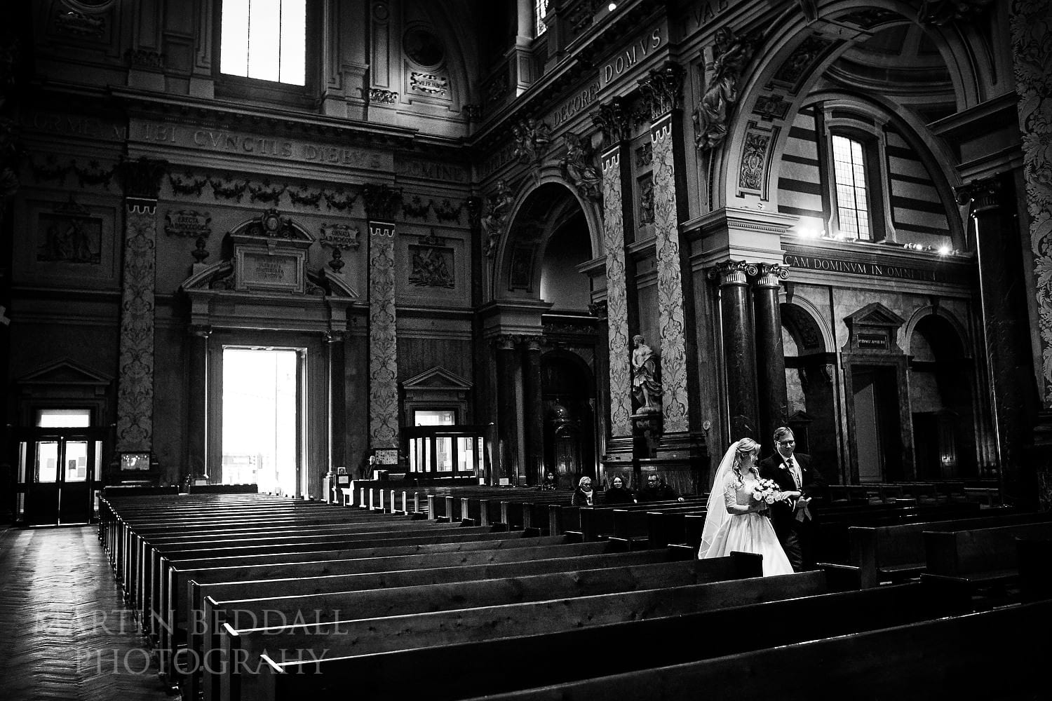 Bride and her father walk down the aisle at Brompton Oratory