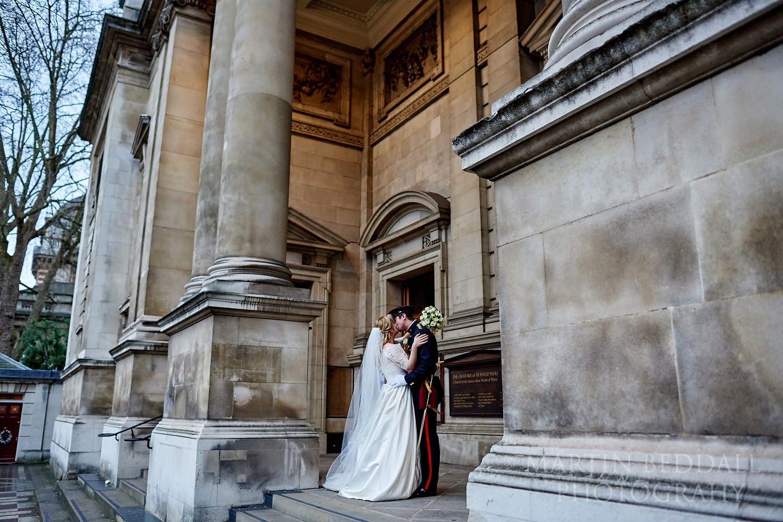 Couple kiss at Brompton Oratory