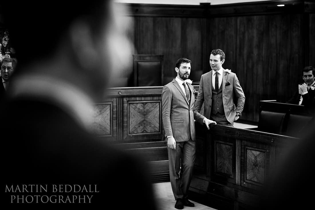 Groom waits in the council chamber at Town House hotel