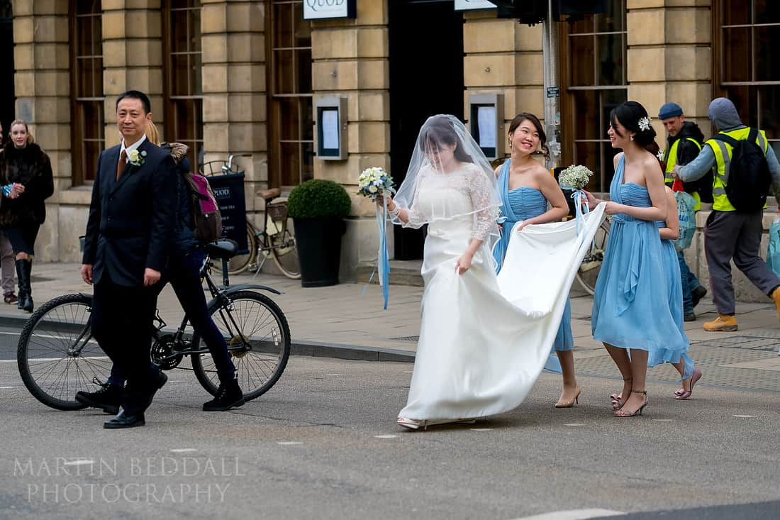 Bride walks across Oxford High Street