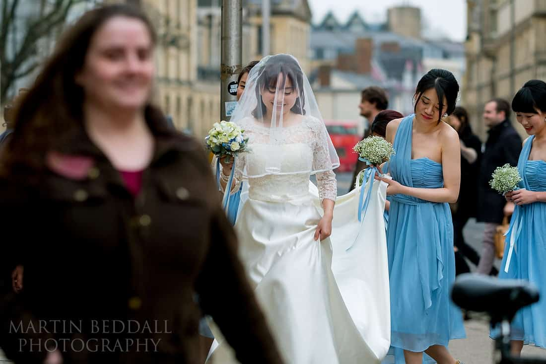 Bride walks along the high street