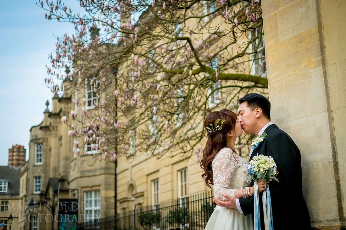Oxford bride and groom kiss