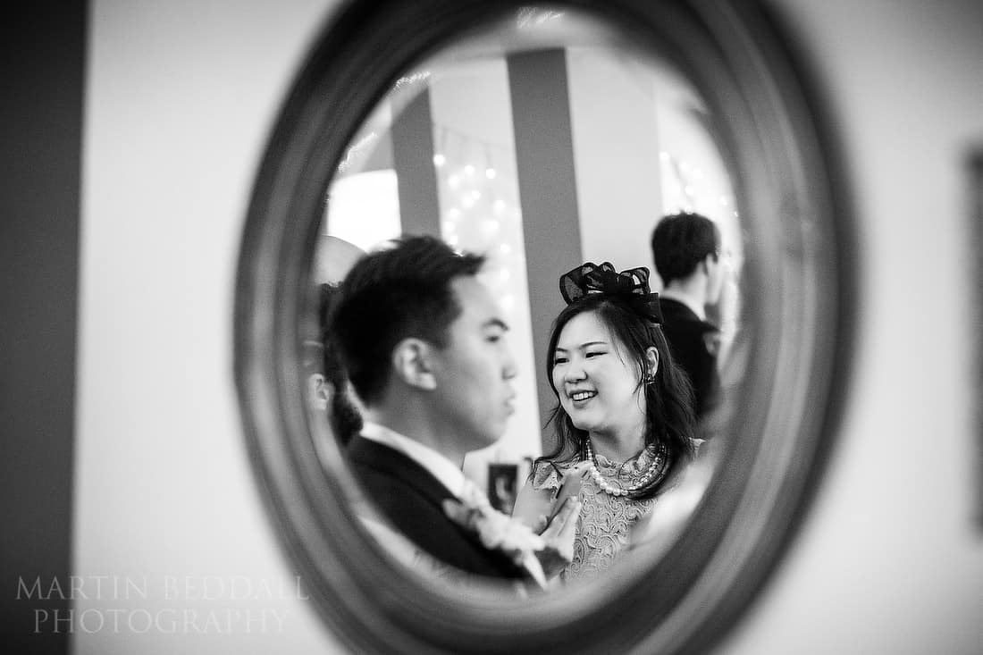 Wedding guest reflected in a mirror