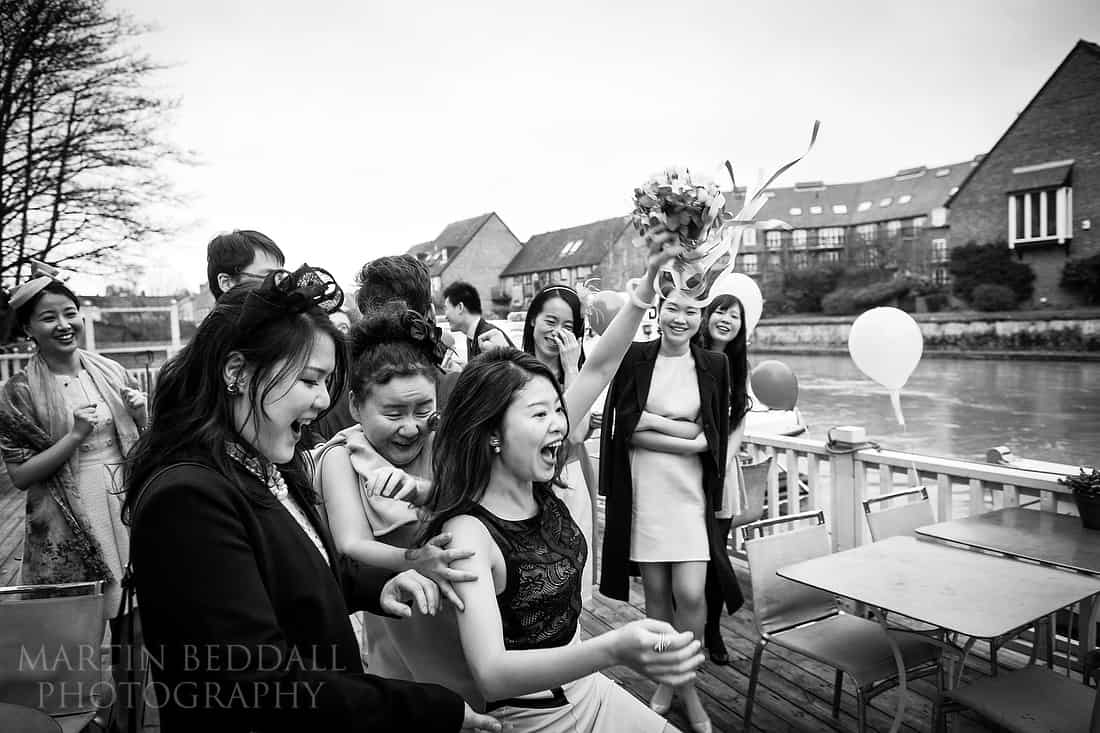 Wedding guest catches the bouquet captured on a Fuji X-Pro2