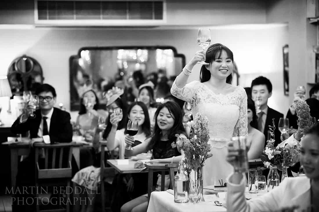 Bride toasts the guests