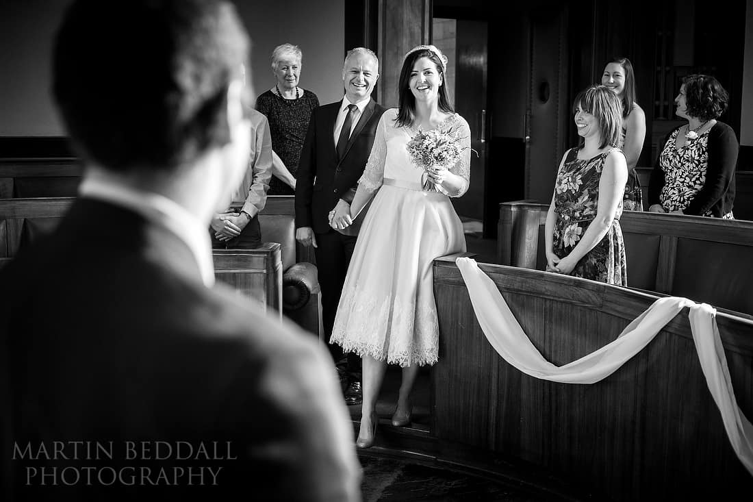 Bride enters the council chamber for the wedding ceremony