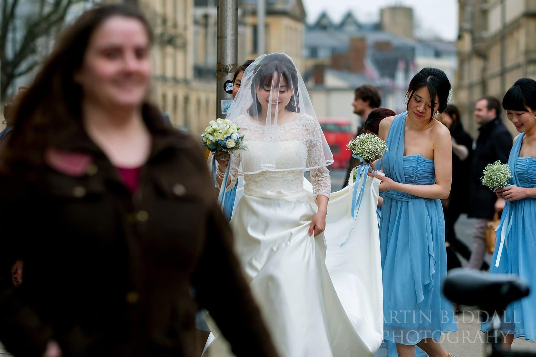 Bride walking to Oxford University Church